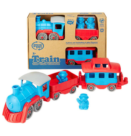 its a red and blue train grey wheels with one car and a caboose with two blue figures. Behind it is the train set in its packaging.