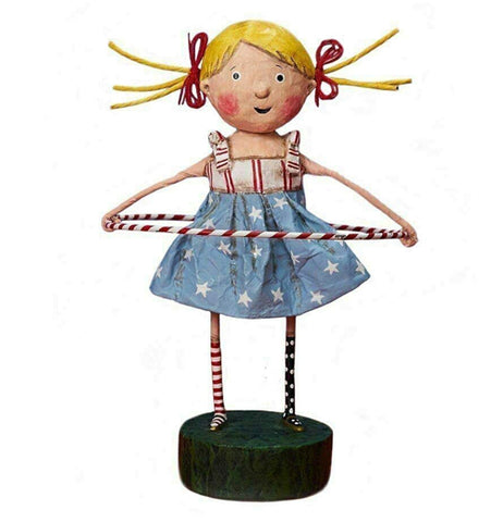 This girl figurine with blonde hair in pigtails is wearing a red and white striped shirt and a blue skirt with white stars. She is playing with a red and white striped hula hoop.