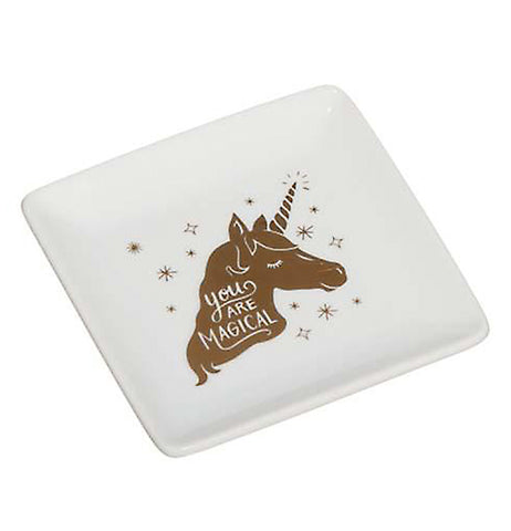 The white trinket dish with the golden unicorn picture in its center is shown from a different angle.