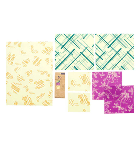 Variety pack of reusable food wrap laid out separately. One Bread size and two small in honeycomb print, two Medium size in purple clover print, and two Large teal geometric print.