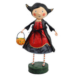 Veronica the Vampire figurine wearing a black jacket and a red, yellow, and black dress and red and white socks. She is holding a kitty candy bucket