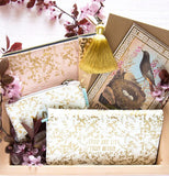 "The ""White Gilded Flowers"" Wallet lays well with other wallets."