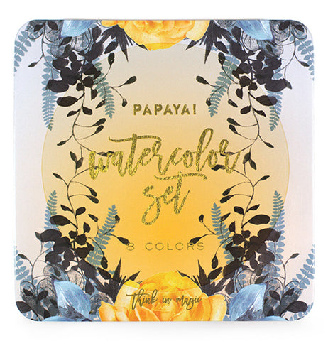 Watercolor set in tin box with image of a yellow sun with green and black plant and yellow flower images with gold foil writing.