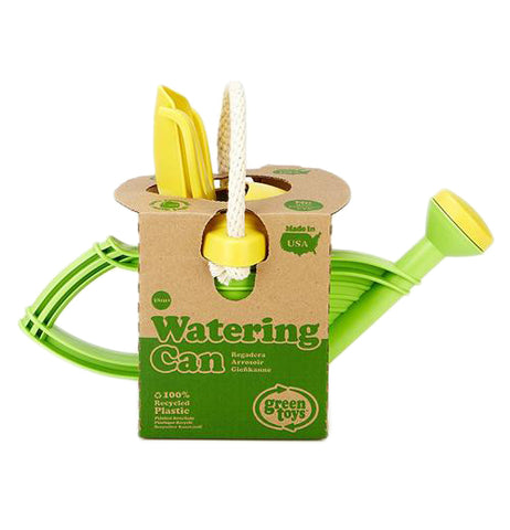 "The green and yellow watering can is shown in its cardboard packaging with the words, ""Watering Can"" in green lettering near the bottom of the box."