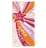 "This folded dish towel shows a star with red, pink, and orange rays coming out of it with the text ""I'm a Girl What's Your SuperPower?"""