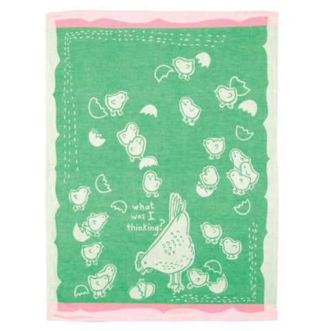 The green towel with pink edges and the white chickens is shown completely unfolded.