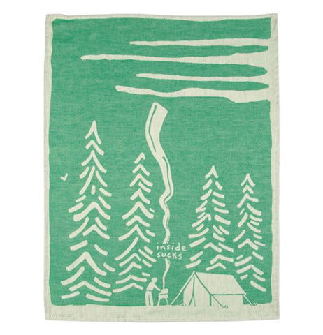 The green towel with white edges and the white barbecue and tree design is shown completely unfolded.
