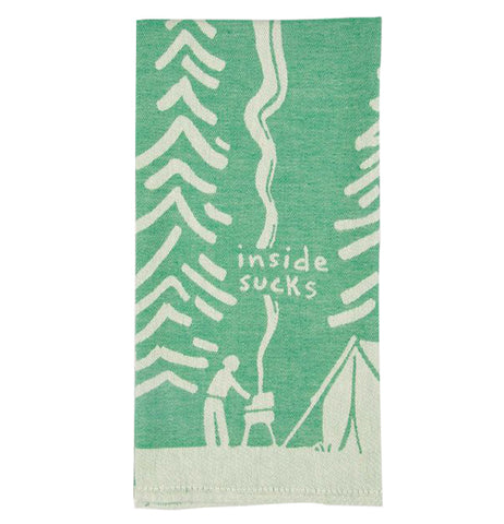 "This green cloth dish towel is shown with a white design of a person operating a smoking barbecue outside a tent. Pine trees are shown in white against the green background. The words, ""Inside Sucks"" are shown in white lettering above the smoking barbecue."