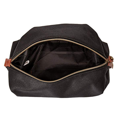 "The Waxed Canvas ""Charcoal' Wash Bag is seen open from above."