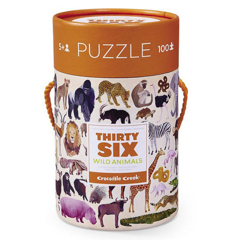 "The ""36 Wild Animals"" Puzzle with 100 pieces are packed in a canister with an orange lid on top."