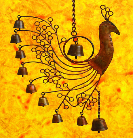 Peacock wind chime over a yellow background with bells and peacock shaped head.