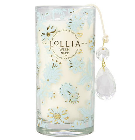 "The white ""Wish"" candle has white flowers and two crystals"