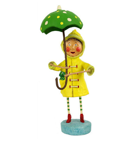 This little girl figurine wears a yellow rain jacket and red boots with a green frog in her jacket pocket. She holds a green umbrella with yellow spots.