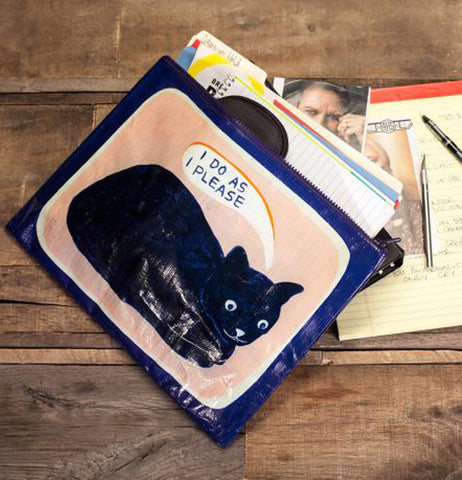 The pouch with the picture of the black cat is shown lying on top of some other pouches on a table.