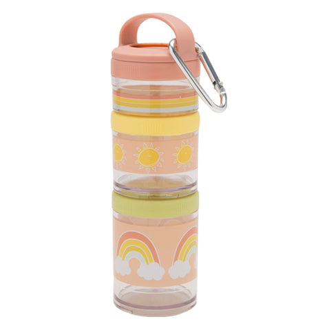 Multiple, plastic stackable snack containers are pastel pink, yellow, green, and transparent in color. A steel carabiner hangs off a small handle. The snack containers are stacked together. They appear to be empty.