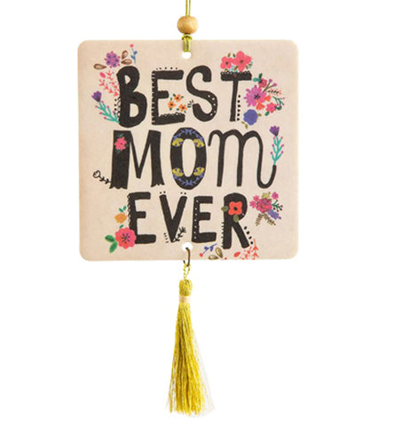 "This white air freshener has the words, ""Best Mom Ever"" in black lettering with pink and purple flowers on the letters."