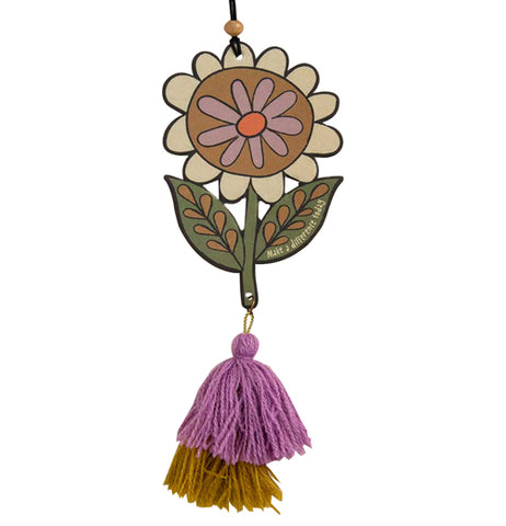 "Flower shaped air freshener with white words that read ""Make a Difference Today"" and pink and orange tassels hanging down on a white background."