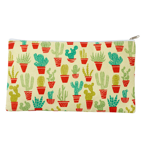 "The ""Happy Cactus"" Apron being kept into a small pouch."