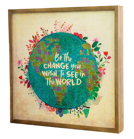 "The ""Be the Change""  Bungalow Art has white text that says, ""Be the Change You Wish to See in the World"" in the center of an illustration of planet earth with flowers growing out the sides."