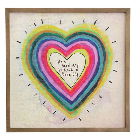 "The Bungalow ""Good Day"" Art features a rainbow heart with a center of a message that reads, ""It's a Good Day to Have a Good Day""."