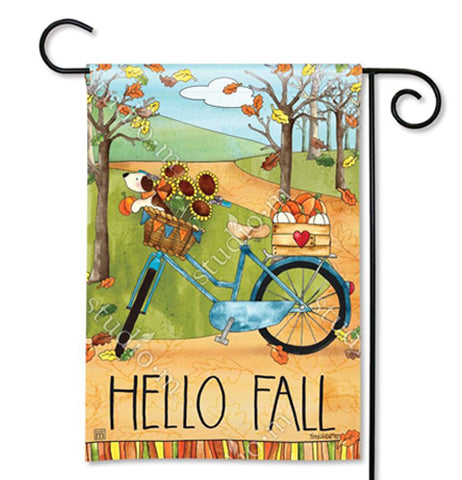 "A flag featuring a Fall forest theme and with a blue bicycle along with the phrase ""Hello Fall"""