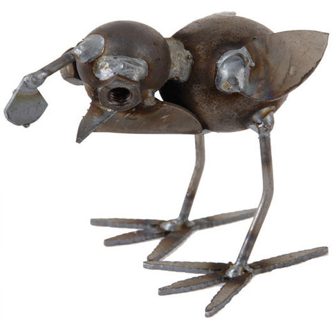 This metal baby quail sculpture head is shown looking down for worms to eat.