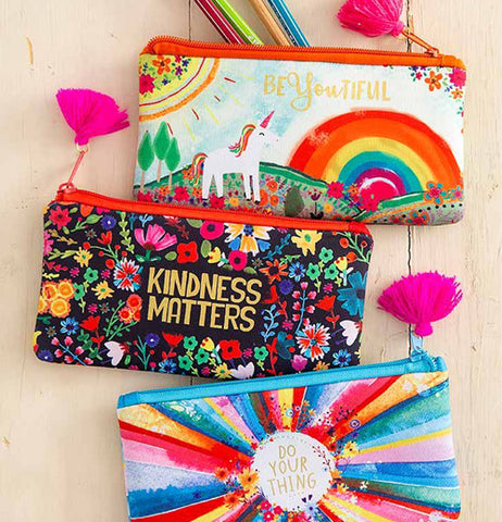 The rainbow design pouch is shown with two other pencil pouches.