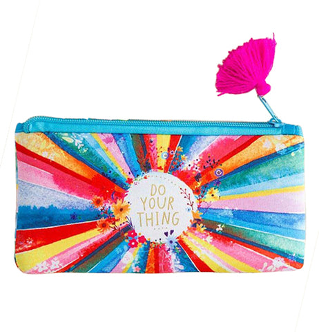 "This pouch with a pink tassel attached to its zipper features a rainbow design of different colors. In the middle of a white circle in gold lettering are the words, ""Do Your Thing""."