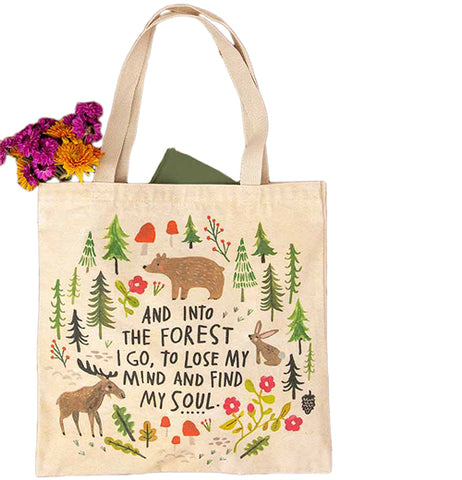 "This cream-colored bag features a forest design comprised of pine trees, mushrooms, a bear, moose, and rabbit. The design encircles the words, ""And Into The Forest I Go, To Lose My Mind And Find My Soul"" in black lettering."