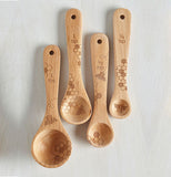 These beechwood spoons have pictures of bees and honeycombs adorning them.
