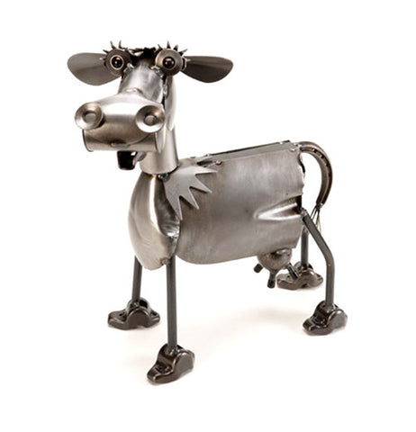 This metal sculpture is of a cow with large hooves.