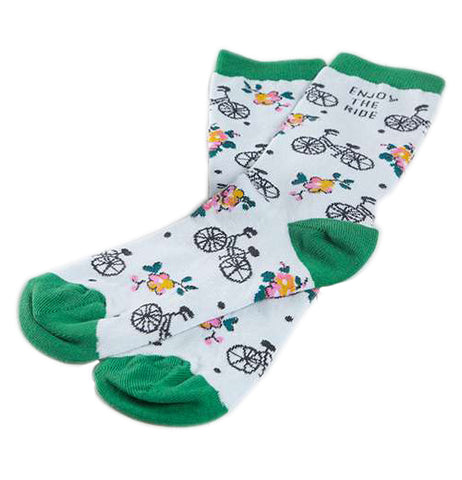 "White socks with a pattern of bikes and flowers that have green at the calf, heel, and toe and says ""Enjoy the ride""."