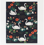 One black notebook with red, white, and pink flowers and white swans.