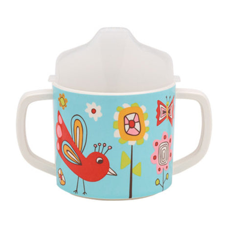 Sippy cup has birds, butterflies, and flowers on it and is blue with a white top.