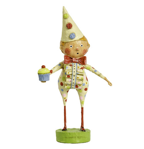 This figurine is of a blonde child in cream colored pajamas with blue, red, and green spots. His cream colored hat also has blue, red, and green spots. He also holds a cupcake.