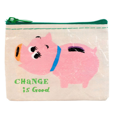 "This coin purse has ""Change is Good"" printed on it. It has a pink piggy bank. It has an off white background."