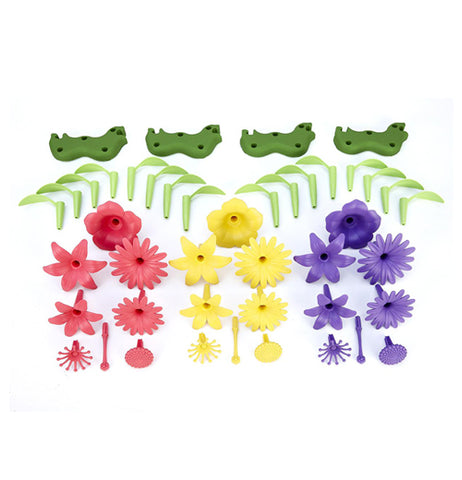 The green plastic bases for the fake bouquets are shown, along with their green leaves, and their pink, yellow, and purple flowers.