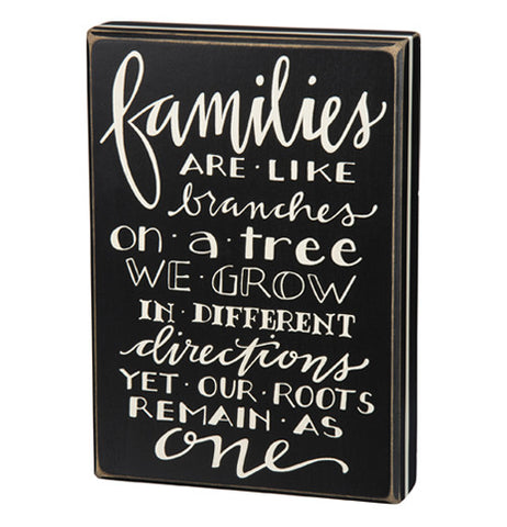 "This box sign says ""Families Are Like Branches On A Tree We Grow In Different Directions Yet Our Roots Remain As One."" The sign is black with white words."