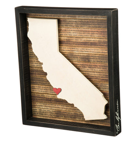 A box sign with a 3D cutout of California with a little red heart.