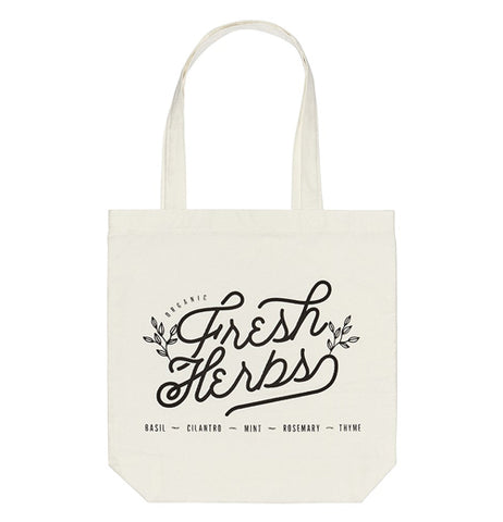 "White canvas tote bag with the words "" Fresh Herbs."" written on the front."