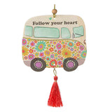 "A colorfully decorated air freshener, ""Follow Your Heart"", in the shape of a VW-like bus with the message to ''Follow your heart."" It's a groovy blast to past for any flower child young, or old."