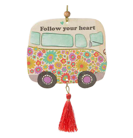 "A colorfully decorated air freshener in the shape of a VW-like bus with the message to ''Follow your heart."" It's a groovy blast to past for any flower child young, or old."