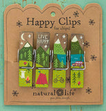 The clips with the camp designs are shown attached to their cardboard packaging against a green background.