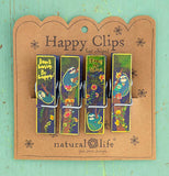 The clips with the sloth pictures are shown attached to their cardboard packaging and sitting on a mint colored background.