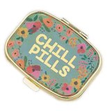 "This teal pill box has a colorful floral border and the message ""Chill Pills"" painted in gold."