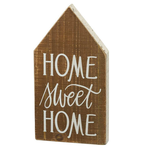 "The Chunky Sitter is a house shaped brown wooden sign that features text that reads, ""Home Sweet Home"" in white words."