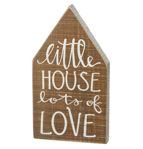 "The ""Little House"" Chunky Sitter is house shaped brown wooden sign that reads, ""Little House Lots of Love"" in white words."