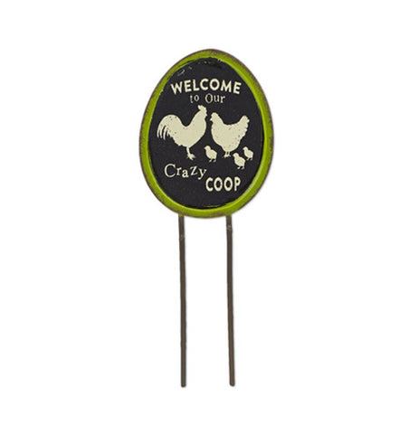 "Mini crazy coop sign with a rooster, hen and baby chicks and ""welcome to our crazy coop"" printed on the sign with a black background and a green ring on the outer edges."