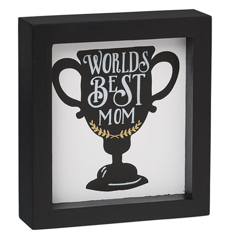 "Black box frame that says ""Worlds Best Mom"" written on a championship cup"