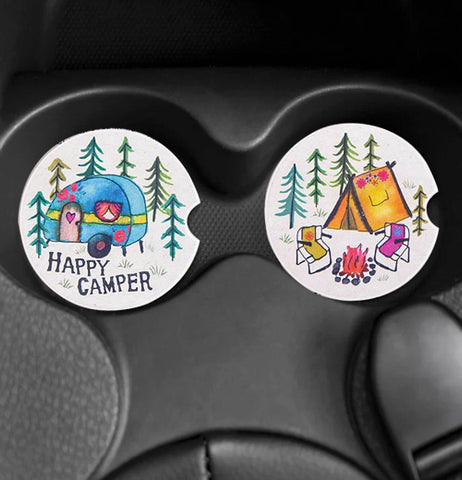 The two car coasters with the camp designs are shown within a car's cup holders.